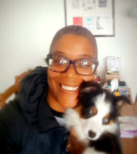 Pet Sitter Millicent with a smiling puppy